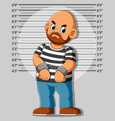 Arrested man posing for mugshot vector