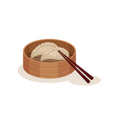 Steamed dumplings or chai kueh in wooden container vector