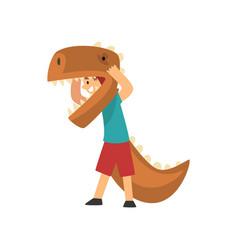 boy wearing dinosaur costume cute kid dressed vector image