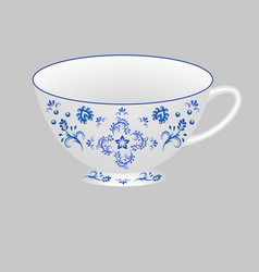 Decorative porcelain tea cup ornate with blue vector