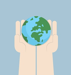 Hand holding the world vector
