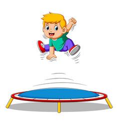Cute little boy jumping on trampoline vector