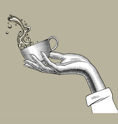 hand holding a coffee cup with a splashed water vector image