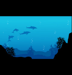 Silhouette of dolphin and reef underwater vector
