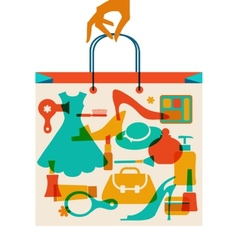 Woman hand holding hopping bag with woman cloth vector image