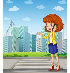 A lady with a cellphone standing at the pedestrian vector