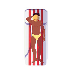 Young afro man with swimsuit in tanning mat vector