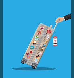 travel bag in hand plastic case with stickers vector image