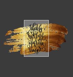 Hand lettering alphabet design on golden brush vector