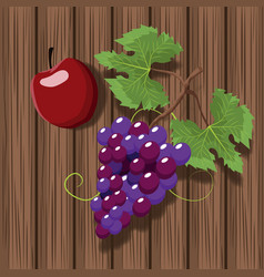 Wine grapes and apple over wooden background vector