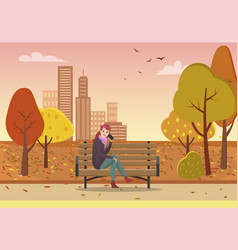 Autumn park and woman talking by phone on bench vector