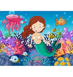 Mermaid and fish swimming under the sea vector