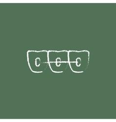 Orthodontic braces icon drawn in chalk vector