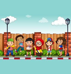 Many children standing on pavement vector