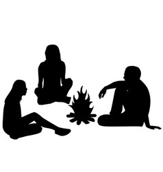 silhouettes of tourists sitting around a campfire vector image