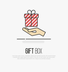 hand holding a striped gift box vector image vector image