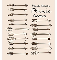 Set of ethnic arrows hand-drawn on a beige vector image