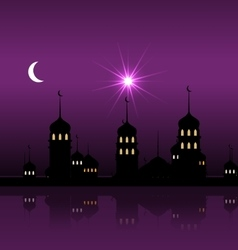 Silhouette mosque against night sky vector