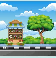 Cartoon flower shop on roadside vector