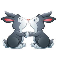 Cute a couple bunnies kissing vector