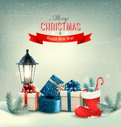 Holiday Christmas background with gift boxes and a vector image