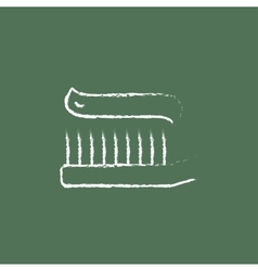 Toothbrush with toothpaste icon drawn in chalk vector image