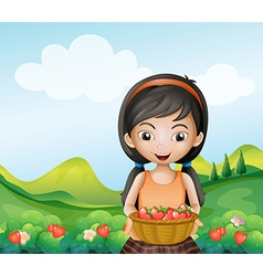 A lady holding a basket of strawberries vector