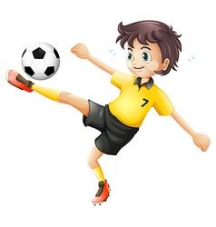 A boy kicking soccer ball vector