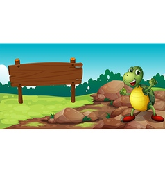 A turtle at the rocky area near an empty signboard vector