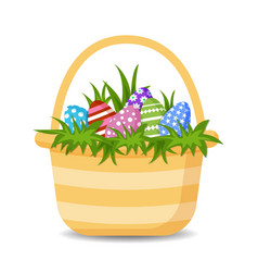 basket with colorful happy easter eggs and grass vector image