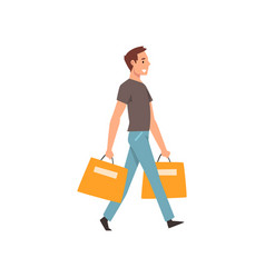 Young man walking with shopping bags guy vector
