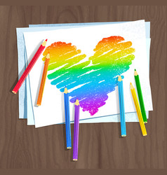 Rainbow colored heart with color pencils and paper vector
