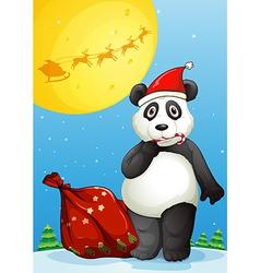 A panda wearing Santas hat while eating a cane vector image