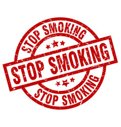 Stop smoking round red grunge stamp vector
