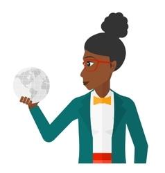 Woman holding globe vector image