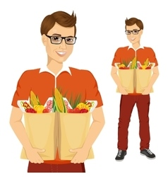 young man carrying grocery paper bags vector image