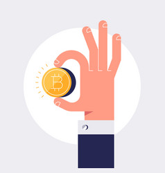 male hand is holding golden bitcoin coin vector image