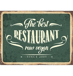 Retro metal sign The best restaurant raw vegan vector image