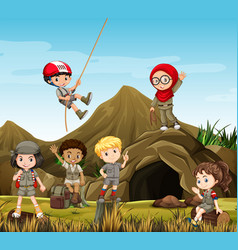 kids camping out by the cave vector image