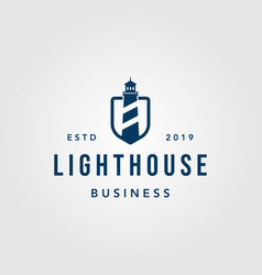 Vintage lighthouse shield logo design vector