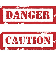 Rubber stamp with text danger and caution vector image vector image