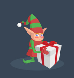 christmas elf holding a gift with a red ribbon vector image