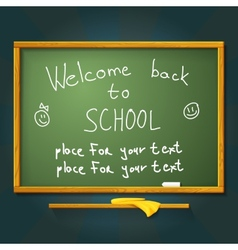 School desk with chalk welcome back message and vector