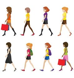 Faceless ladies walking vector image
