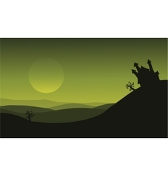Halloween castle silhouette on green backgrounds vector
