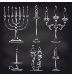 Hand drawn candles set on chalkboard vector image
