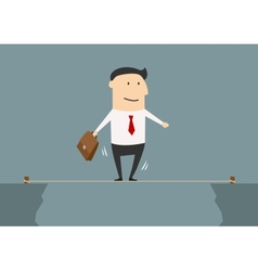 Businessman balancing on a tightrope vector image