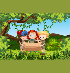 Children holding a map forest scene vector