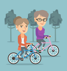 retired caucasian women riding bicycles in park vector image
