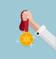 Gold medal hold in hand vector